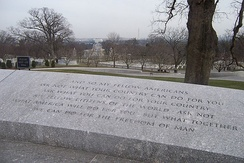 The most famous passage from the inaugural address is etched in stone at Kennedy's gravesite in Arlington National Cemetery, with the Lincoln Memorial and Washington Monument in the background.
