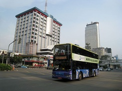 Jakarta double-decker city tour bus passing through Jakarta landmarks and points of interest