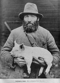 Swedish pig farmer with piglet, early 20th century