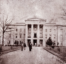Governor Reid is seen in the foreground of this 1861 photo of the North Carolina State Capitol.