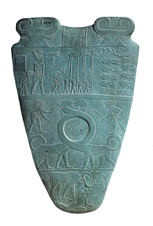 Narmer Palette, with the two serpopards representing unification of Upper and Lower Egypt, 3000 B. C.