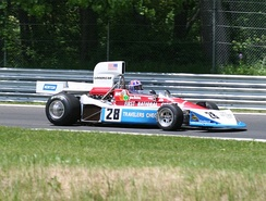 A Penske PC3 being raced in a Historic Grand Prix at the Lime Rock Park circuit in 2009.