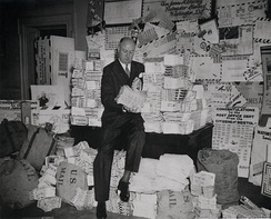 Farley sits on a pile of air mail letters in 1938.