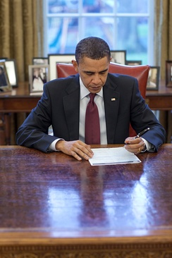 U.S. President Barack Obama completing his census form in the Oval Office on March 29, 2010.