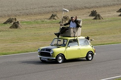 "Rowan Atkinson re-enacting a famous scene from the episode ""Do-It-Yourself Mr. Bean"" on a Mini at Goodwood Circuit Revival 2009"