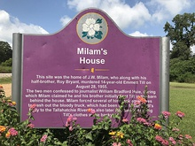 Sign identifying the site of Milam's house, near Glendora Gin.