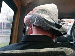 Improvised hat cover of an Orthodox Jew on a rainy day in Tel Aviv.