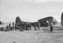 British airborne troops wait to board an American WACO CG4A glider.