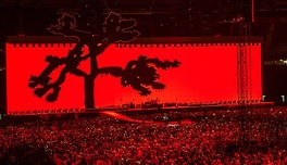 U2 performing in Rome, during a concert tour commemorating the 30th anniversary of The Joshua Tree