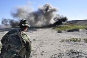 Third Phase A student detonates an explosive charge on San Clemente Island as part of his basic demolitions training.