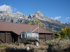 Drum or barrel trap used to safely relocate bears; currently parked adjacent to a building in Grand Teton National Park in Wyoming, United States