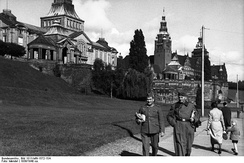 Two soldiers of the German Wehrmacht take a stroll along the riverfront in Stettin