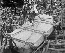 People on Nias Island in Indonesia move a megalith, c. 1915.  Digitally restored.