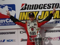 Wheldon celebrating his victory at the 2005 Indy Japan 300