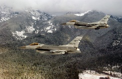 Two U.S. Air Force General Dynamics F-16C Block 30D Fighting Falcon aircraft from the 186th Fighter Squadron Vigilantes, 120th Fighter Wing, Montana Air National Guard, in flight near Nellis Air Force Base, Nevada (USA), on 7 December 2001.