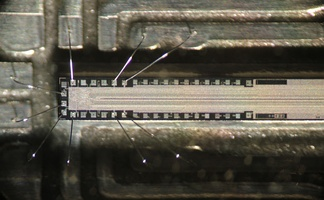 The chip in a fax machine. Only about one quarter of the length is shown. The thin line in the middle consists of photosensitive pixels. The read-out circuit is at left.