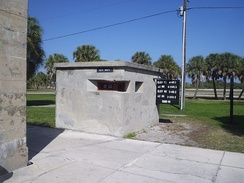 A data booth serving a mortar pit. The display board posted azimuth, elevation, and powder charge data for the mortars.