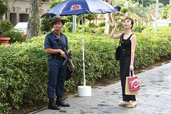 A trooper of the Gurkha Contingent of the Singapore Police Force gives directions to a member of the public.