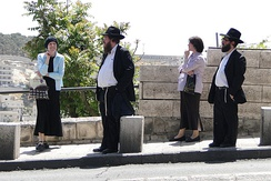 Typical Haredi dress for men and women