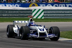 "Juan Pablo Montoya in the ""Walrus-Nose"" designed Williams FW26 during the 2004 United States Grand Prix when he qualified fifth for the race but was disqualified for illegally using the spare car"