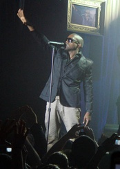 Kanye West performing in 2006, wearing a fitted sportcoat
