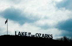 The Lake of the Ozarks is one of several man-made lakes in Missouri, created by the damming of several rivers and tributaries. The lake has a surface area of 54,000 acres and 1,150 miles of shoreline and has become a popular tourist destination.
