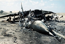 An Iraqi MiG-29 aircraft lies in ruins after it was destroyed by coalition forces during the Persian Gulf War's Operation Desert Storm.