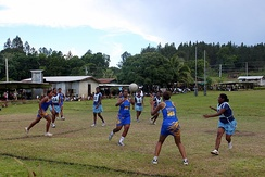 A pass takes place during a women's netball game in Fiji.