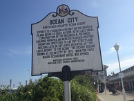 An Ocean City historical marker in August 2013. It tells a brief history of the town.