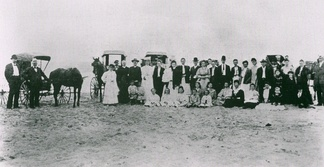 A church group from Ocean View, Delaware, at a fish fry along the uninhabited Atlantic coast east of Ocean View in 1880. Bethany Beach would be founded in this area 21 years later. This may be the first photograph ever taken of what was to become Bethany Beach.[30]