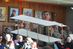 Park Ranger Tom White demonstrates a replica of the Wright brothers 1899 box kite at the Wright Brothers National Memorial