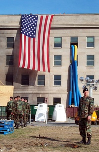 Preparing to lower the flag at the Pentagon on October 11, 2001