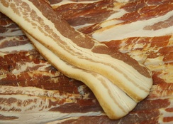 Uncooked strips of side bacon