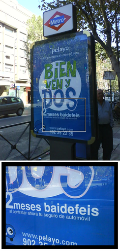 "Spanish street ad in Madrid humorously showing baidefeis instead of the Spanish gratis (free).Baidefeis derives from the English ""by the face""; Spanish: por la cara, ""free"". The adoption of English words is very common in Spain."