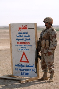 Salah Ad Din Governorate (31 March 2006) – An Iraq Army soldier assigned to the 1st Battalion, 1st Brigade, 4th Division, mans a checkpoint during Operation Red Light II, on the outskirts of Monfia village in the Western Desert