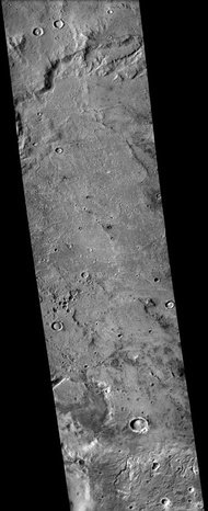 Sklodowska (Martian crater), as seen by CTX camera (on Mars Reconnaissance Orbiter).  Small channels are visible along the eroded, southern rim.