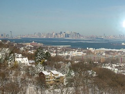From left to right, as seen from northeastern Staten Island: Jersey City, Statue of Liberty, Lower Manhattan, and Downtown Brooklyn.