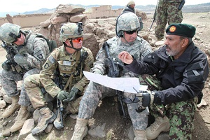 U.S. Army soldiers in May 2011, wearing the ACU in the Universal Camouflage Pattern, along with its replacement MultiCam pattern (second from left) in Paktika province, Afghanistan