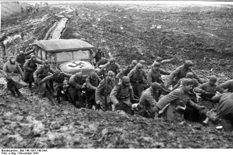 Wehrmacht soldiers pulling car from the mud, November 1941
