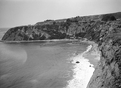 The headlands and pier at Dana Point, ca. 1925, prior to construction of the harbor