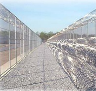 Barbed wire is a feature of prisons.