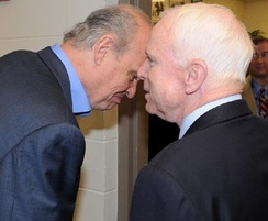 Thompson and McCain converse backstage prior to the debate