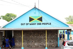 Jamaica motto on a building at Papine High School in Kingston, Jamaica.