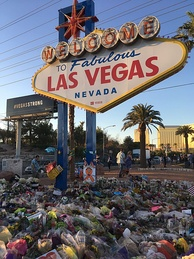 The Welcome to Fabulous Las Vegas sign adorned with flowers on October 9, 2017, a week after the shooting