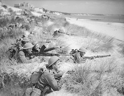 Men of the 7th Battalion, Green Howards among the sand dunes at Sandbanks, near Poole, Dorset, 31 July 1940.