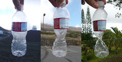This plastic bottle was sealed at approximately 14,000 feet (4,300 m) altitude, and was crushed by the increase in atmospheric pressure, recorded at 9,000 feet (2,700 m) and 1,000 feet (300 m), as it was brought down towards sea level.