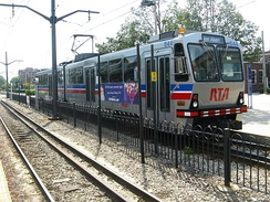 An RTA train arrives at the Shaker Square station