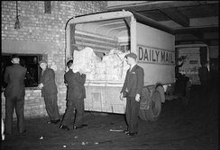Bundles of newspapers loaded into the back of a 'Daily Mail' van in the early hours for delivery to newsagents