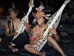 Two Dayak tribemen playing Sapeh in Sarawak