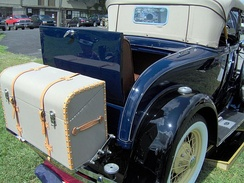 Early automobiles had provision for an external trunk mounting as on a 1931 Ford Model A, in addition to the rumble seat